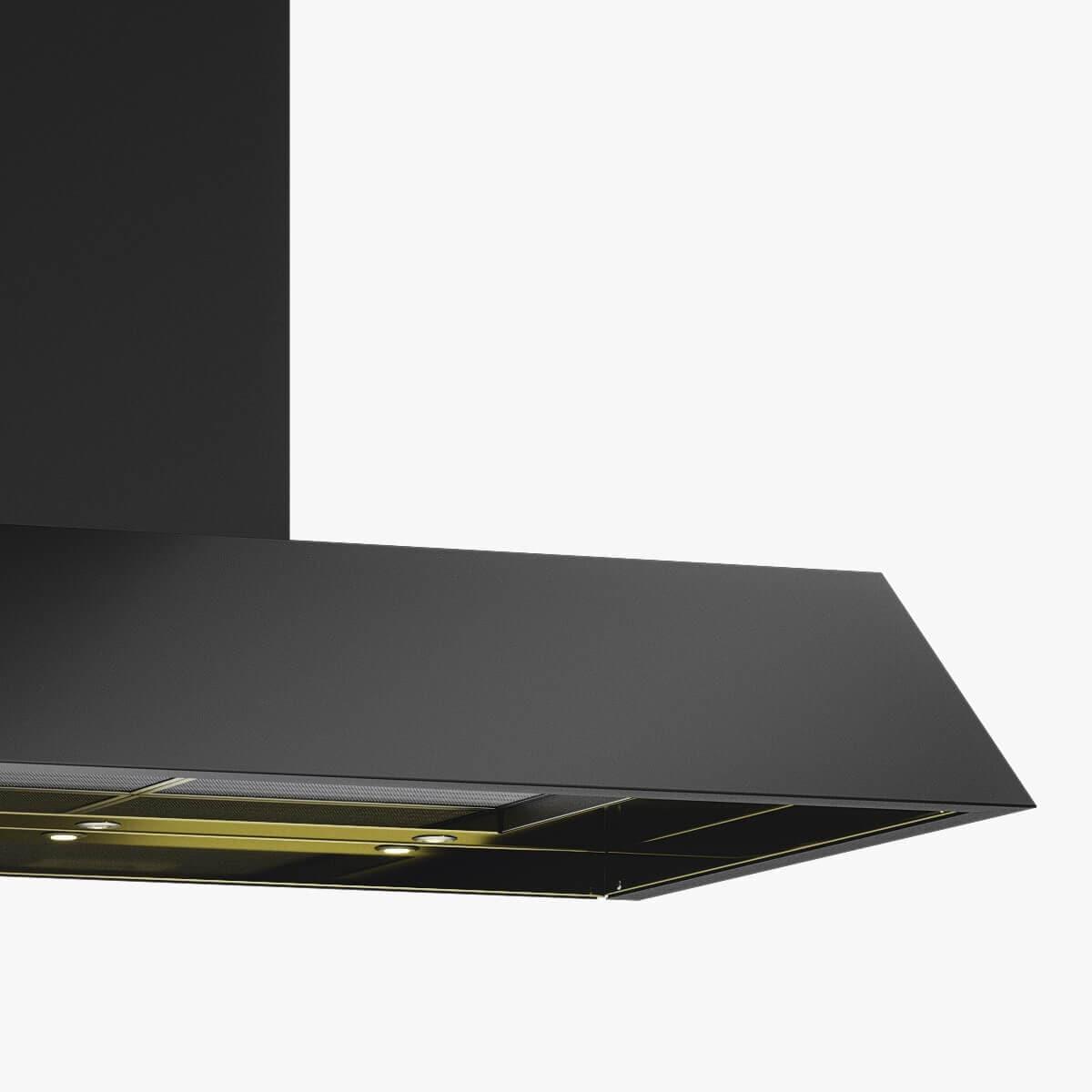 Detaljer på vägghängda köksfläkten Area i svartoxiderad metall med undersida i mässing.