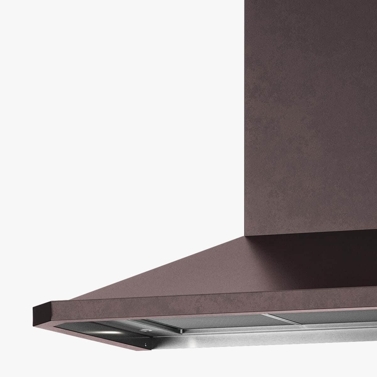 Detaljer på vägghängda köksfläkten Carisma i rödoxiderad metall.